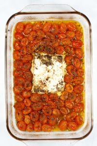 Baked vegan feta and tomatoes in a pan.
