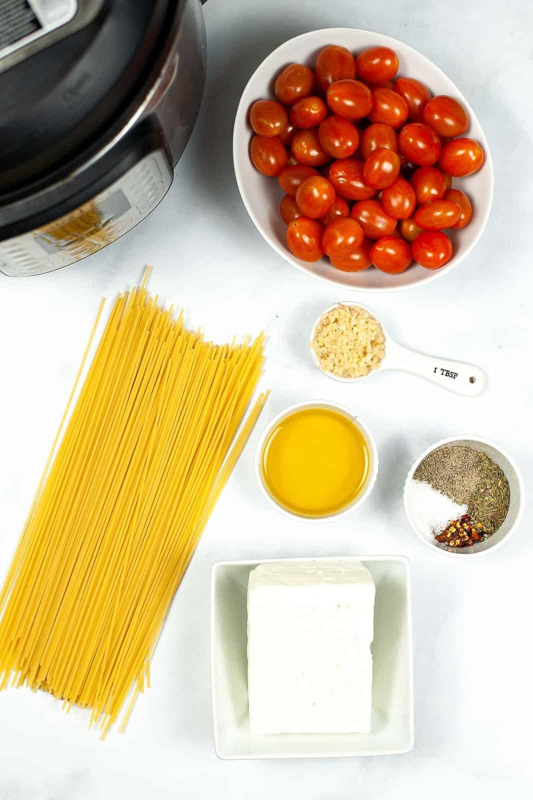 Ingredients to make vegan baked feta pasta.