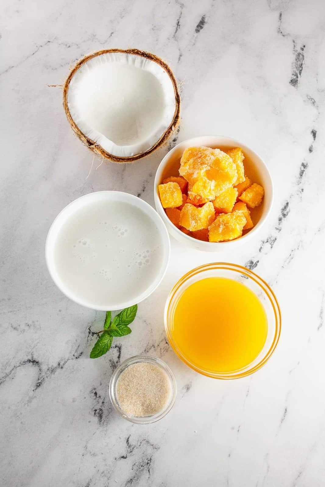 Ingredients to make mango popsicles.