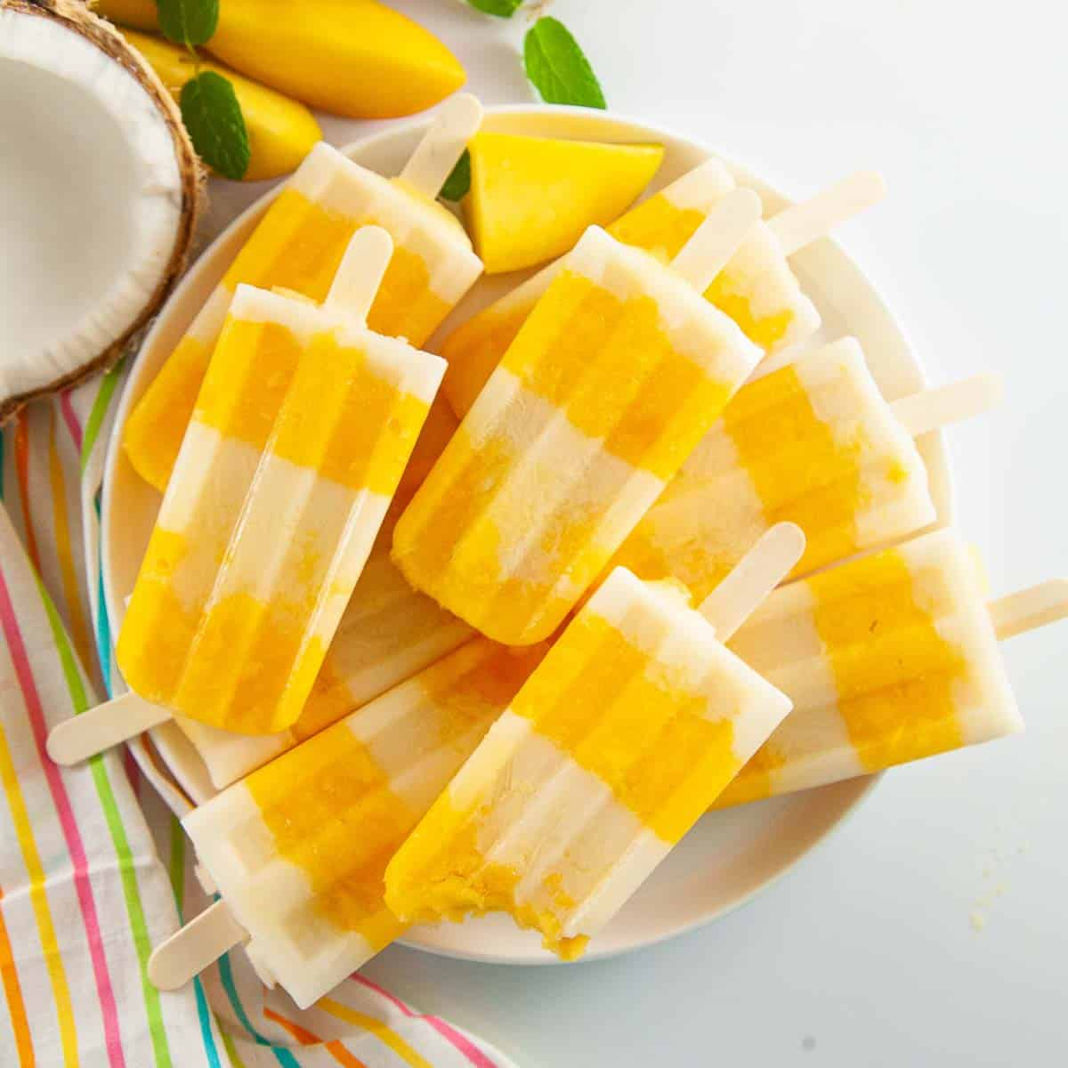 Mango popsicles on a plate.
