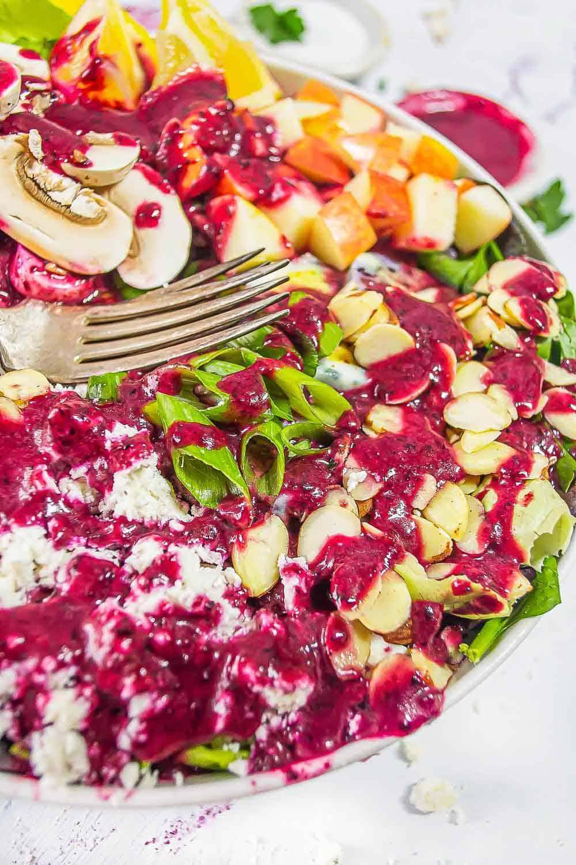 Salad with blueberry vinaigrette dressing.