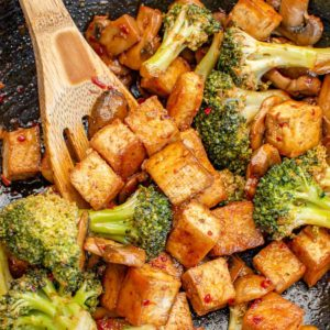 Broccoli and tofu stir fry in a wok.