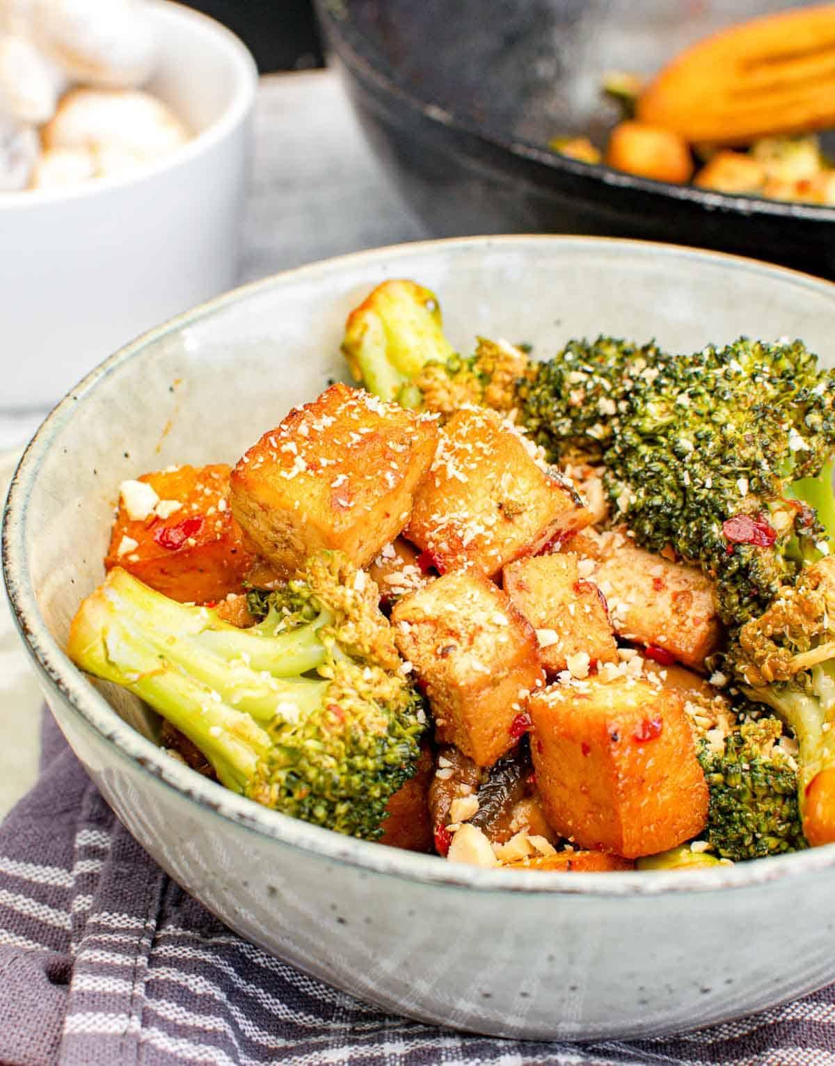 Broccoli tofu mushroom stir fry in a bowl.