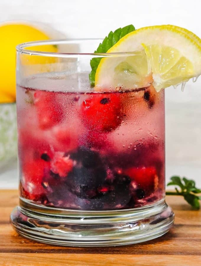 Glass of berry spritzer drink.