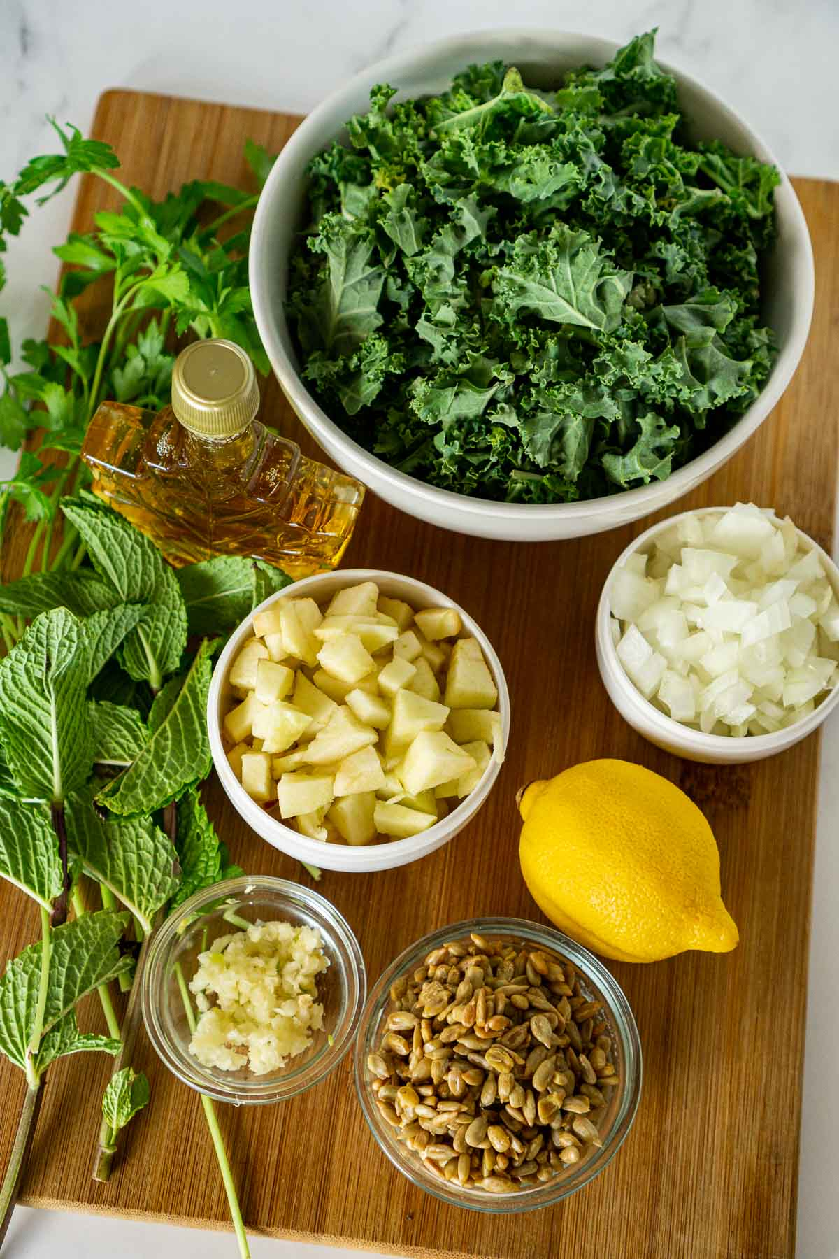 Ingredients to add to rice salad: kale, apples, sunflower seeds, onion, garlic, herbs, lemon juice, and maple syrup.