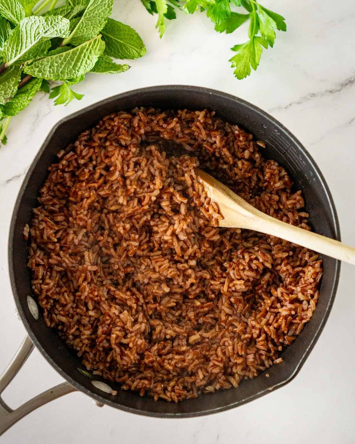 Cooked red rice in a pot.
