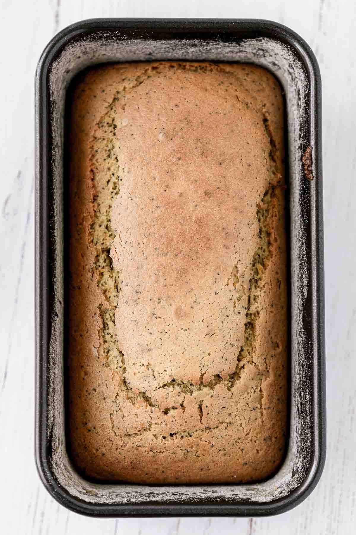 Top of a lemon poppy seed load baked in a bread pan.